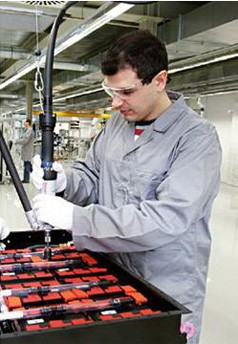 Man using both hands to operate Rexroth machinery